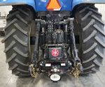 Side view of ProTrakker 300DB Hydraulic Hitch mounted on New Holland tractor