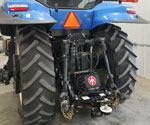 Rear view of ProTrakker 300DB Hydraulic Hitch mounted on New Holland tractor