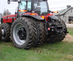 Side view of a ProTrakker 400DX mounted on a Case MX215 tractor